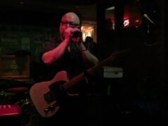 screenshot of Black Francis/Frank Black/Charles addressing the intimate audience